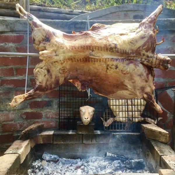 whole lamb spit braai with lamb head